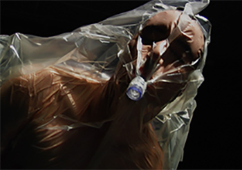 Shirtless man with plastic bag over head