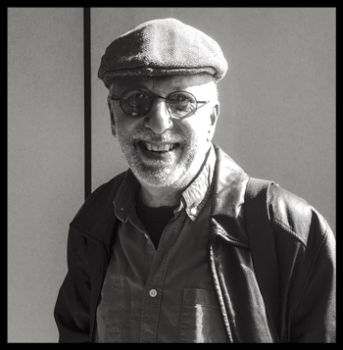 Grayscale photo of man in hat