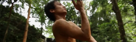 young man dancing in forest no shirt