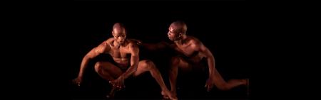 Two men dancing in the dark
